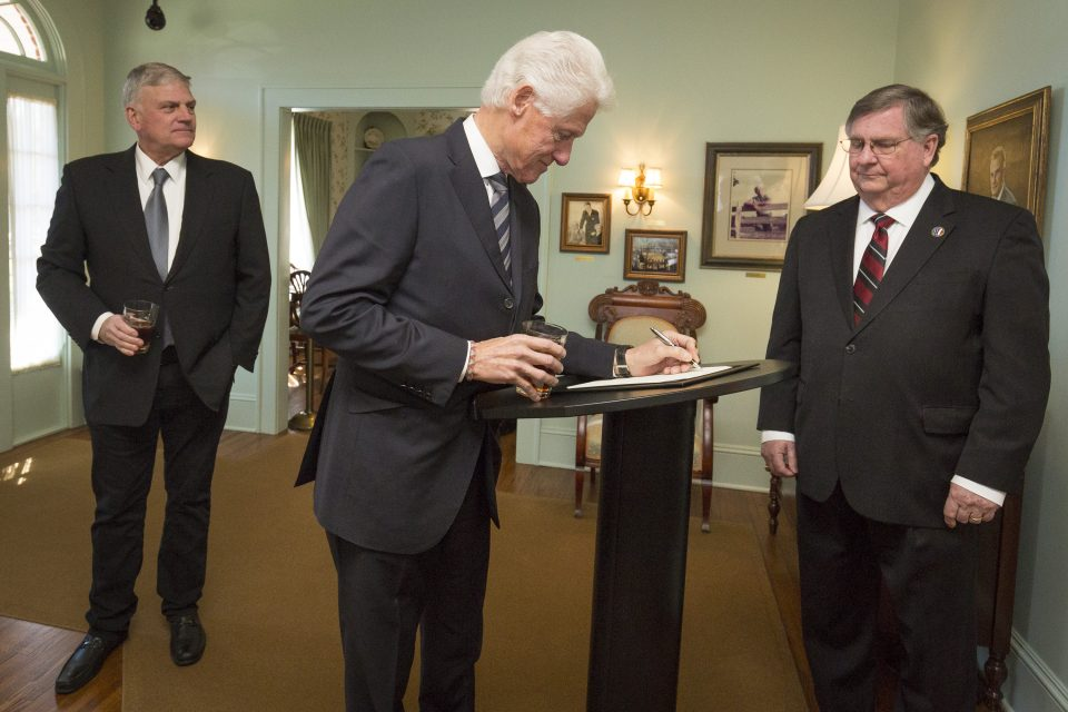 President Clinton signs guest book