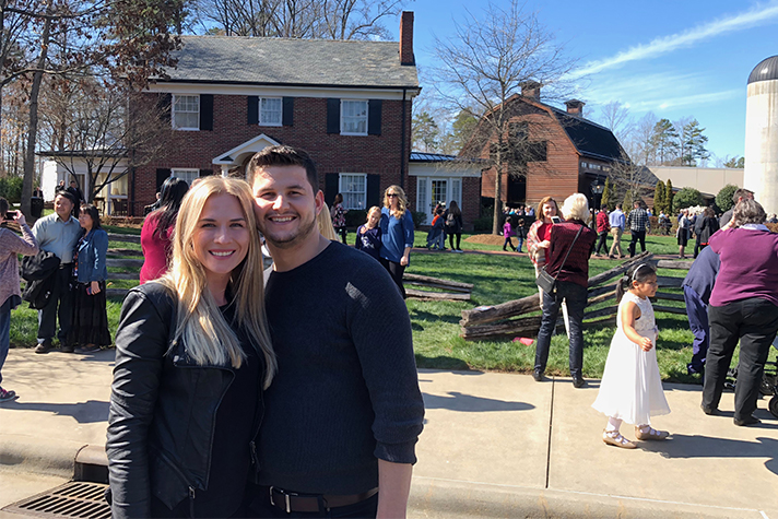 young couple in front of Billy Graham Library