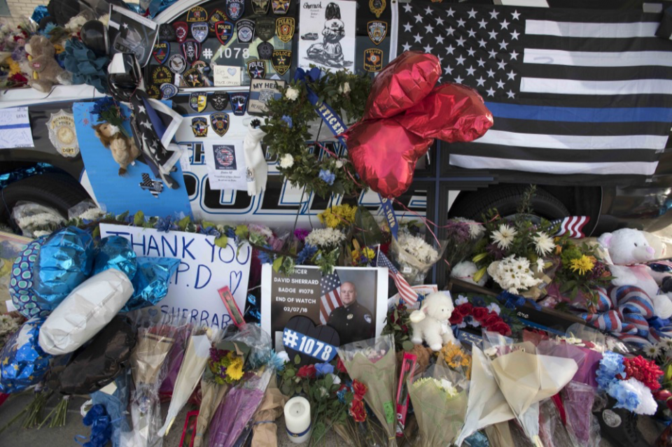 Memorial filled with notes, flowers and memorabilia
