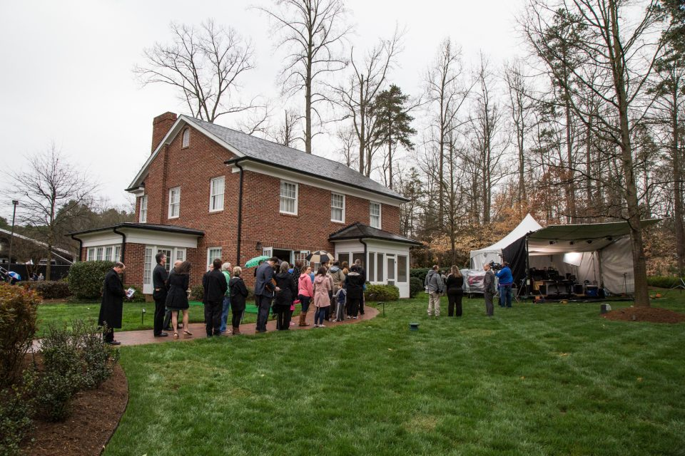 People stand in line outside the Graham family Homeplace