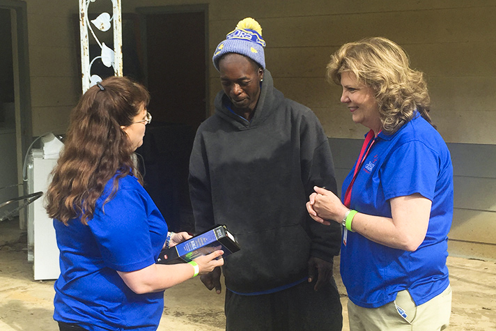 chaplains and homeowner with Bible