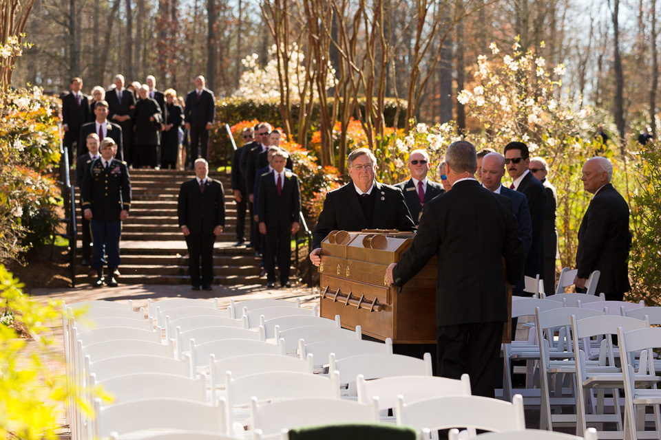 Pallbearers carry Mr. Graham's casket to the interment service