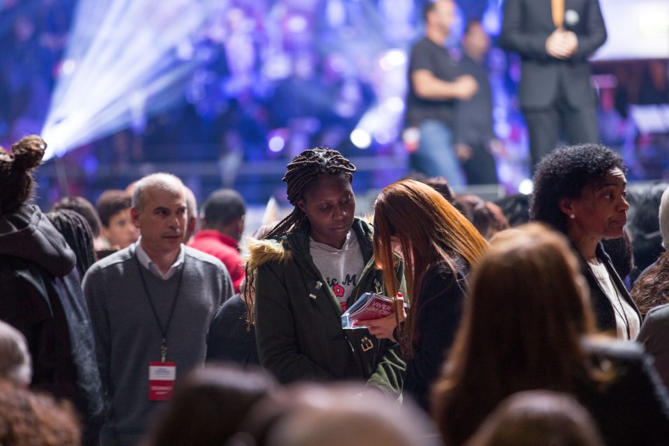 Counselor prays with woman