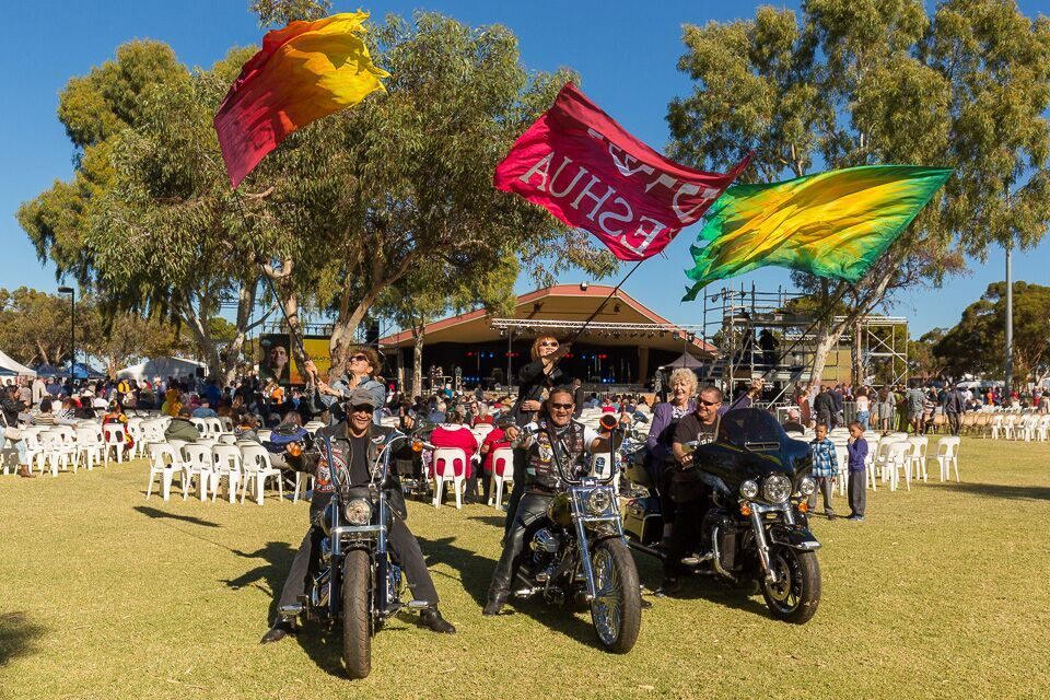 motorcyclists with flags