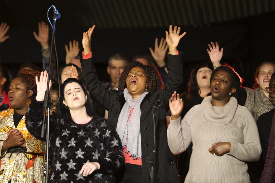 Choir with hands up in worship