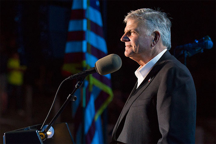 Franklin Graham stands behind podium