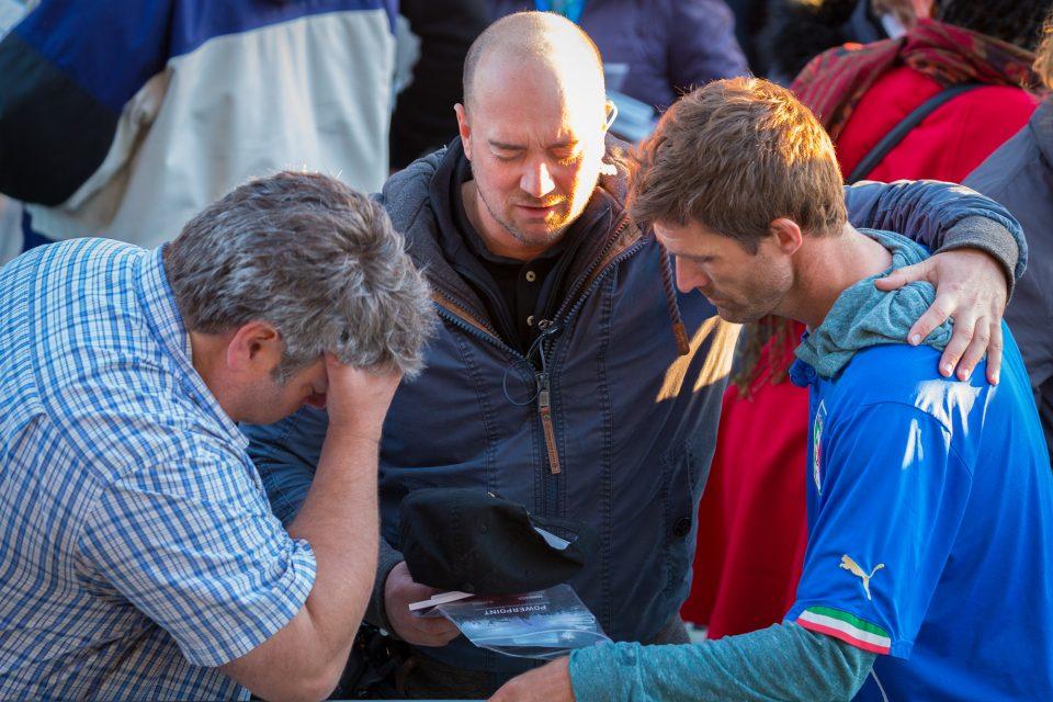 Three men praying