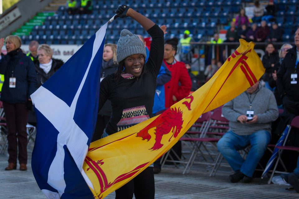 Young woman waving flags