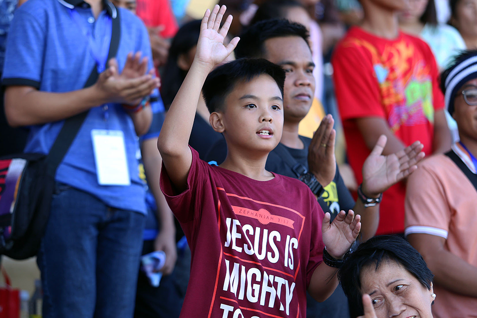 Filipino boy worshipping