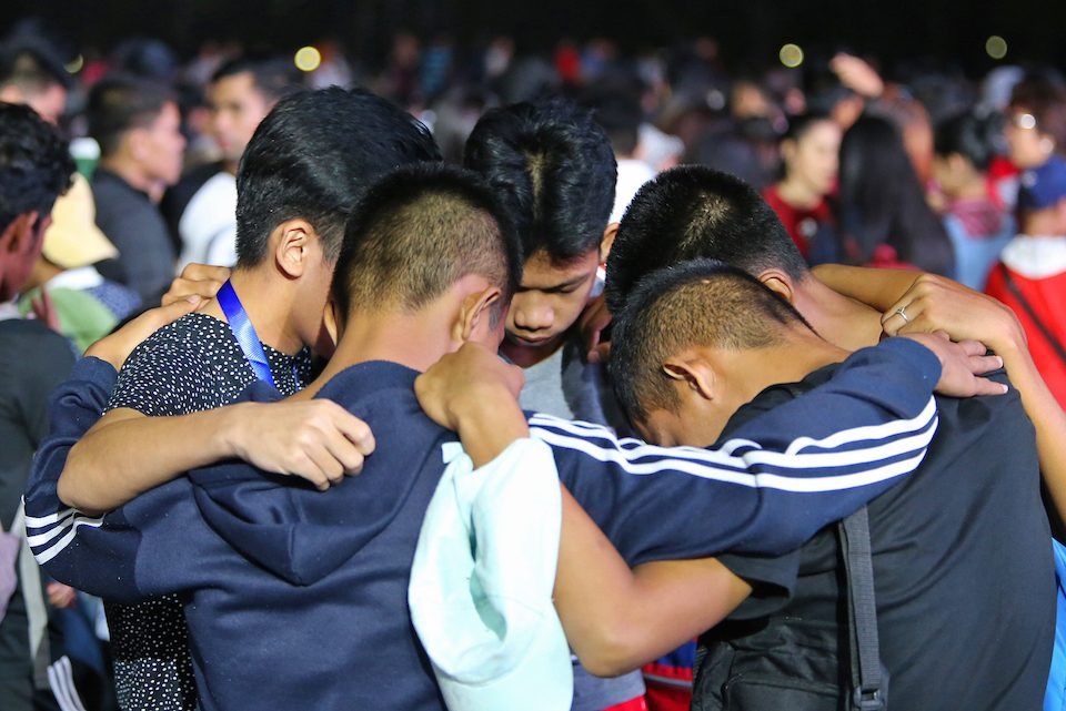 Filipino boys praying