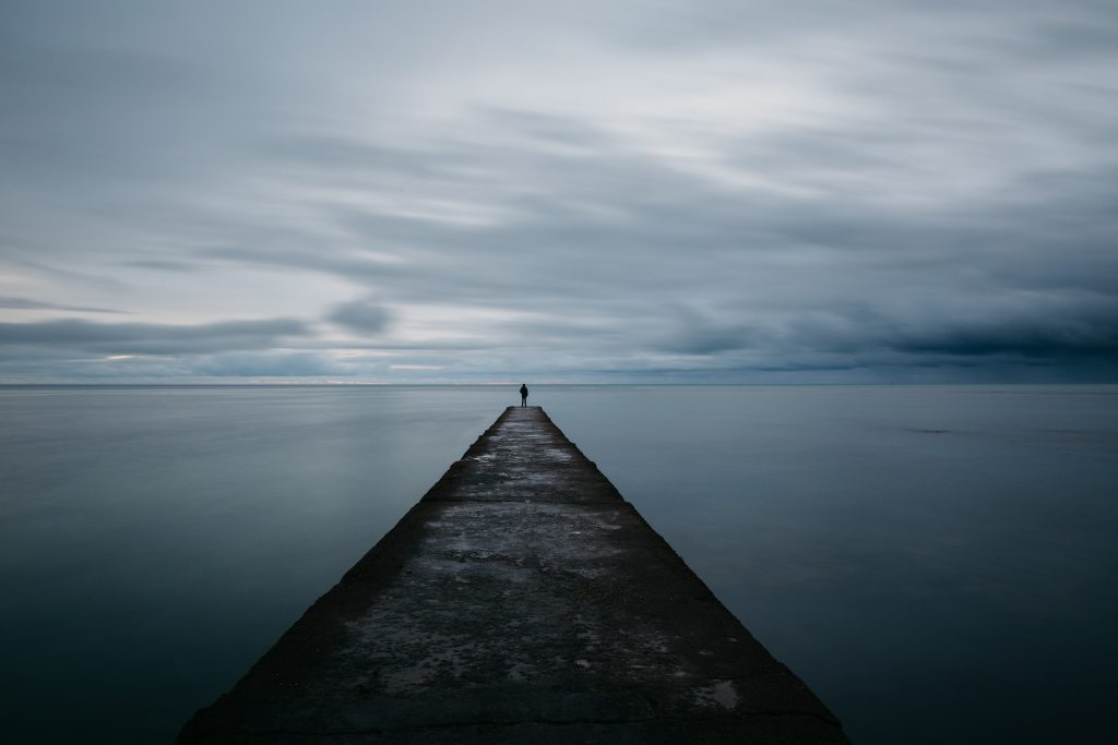 man at the end of a jetty