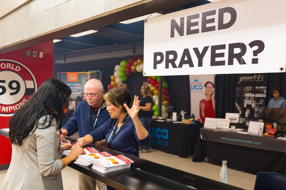 Prayer is so valuable and doesn't cost anything. This woman stopped by a booth set up in the CAA Arena to be prayed over.