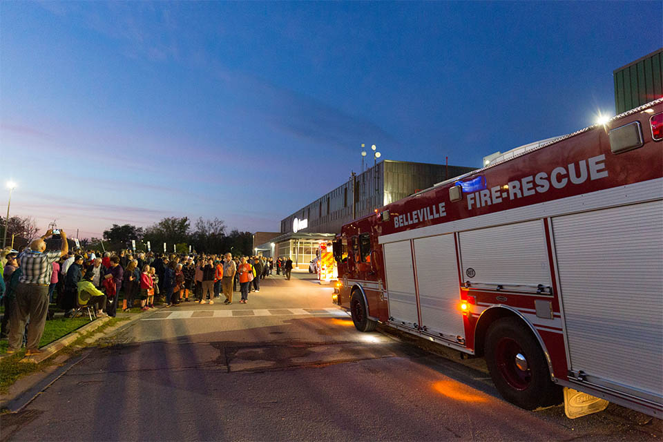 The Belleville Fire Department cleared the CAA Arena while thousands stood outside, lifting their voices in worship.