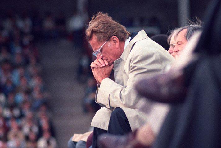 Billy Graham praying
