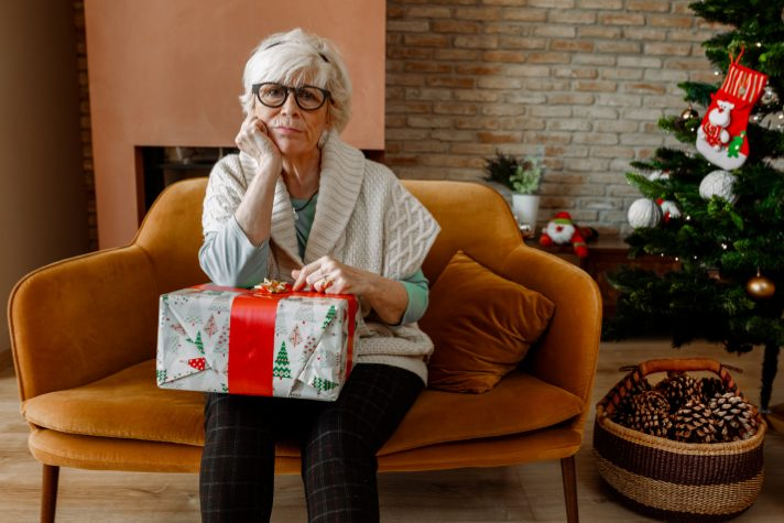 sad woman holding Christmas gift