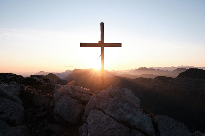 Wooden cross in the mountains