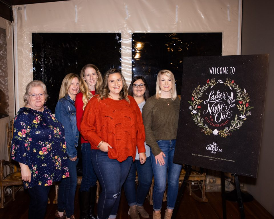 "Group of women pose by ""Ladies Night Out"" sign"
