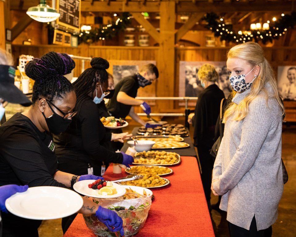 Servers putting food on plates