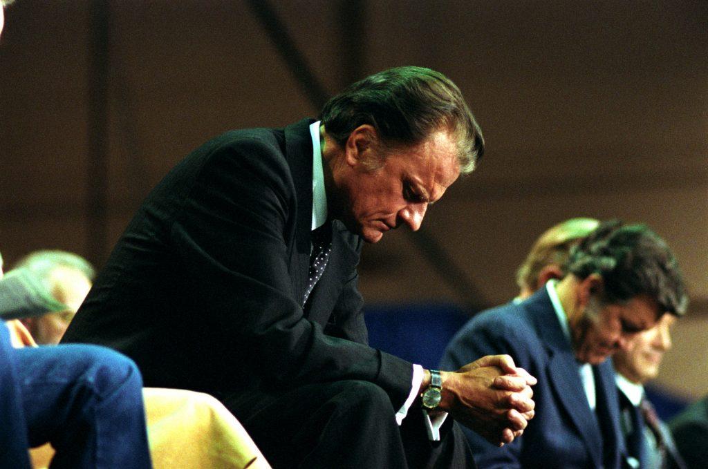 Billy Graham bowed in prayer
