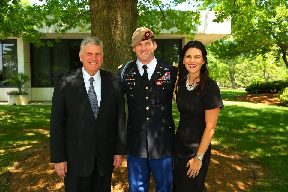Edward Graham standing with Franklin Graham and Cissie Graham Lynch