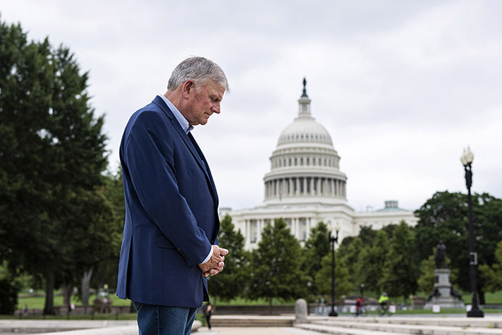 Franklin Graham praying in front of Capitol