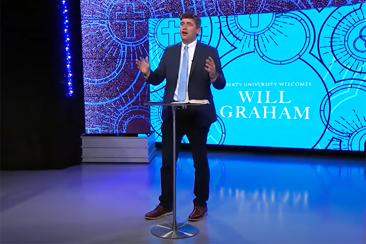 Will Graham speaking from stage at Liberty University