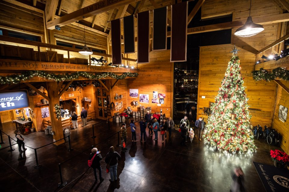People inside the Billy Graham Library; Christmas tree
