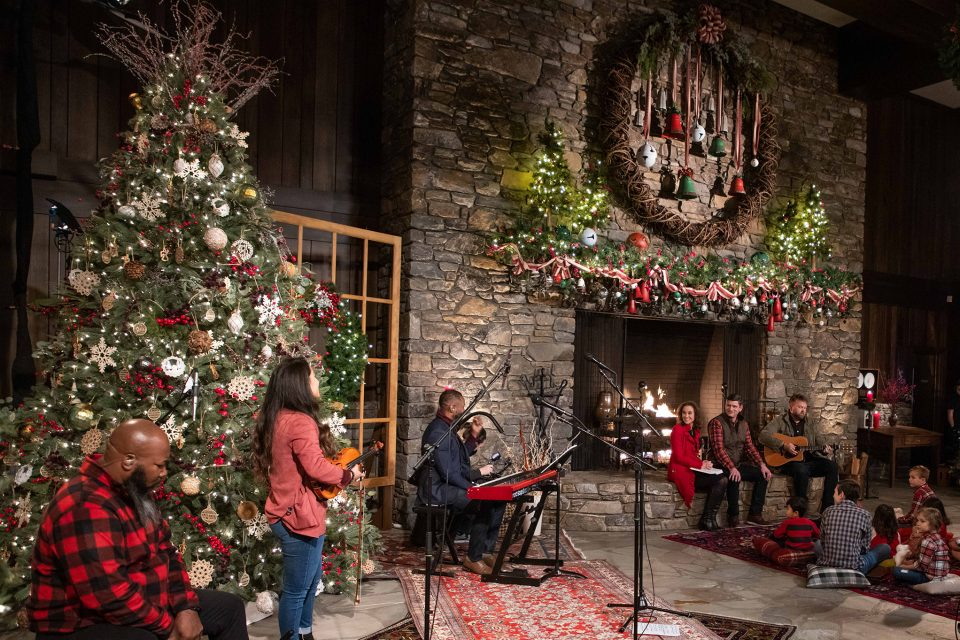 Large stone fireplace, Christmas tree, participants