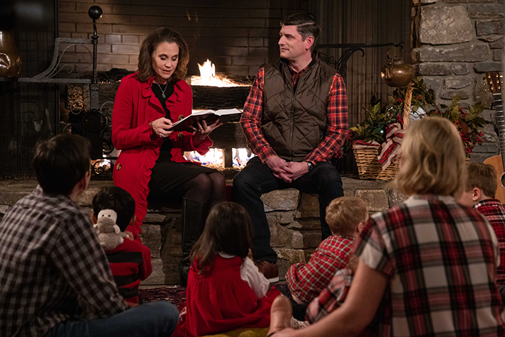 Will and Kendra Graham; children sitting to Christmas story