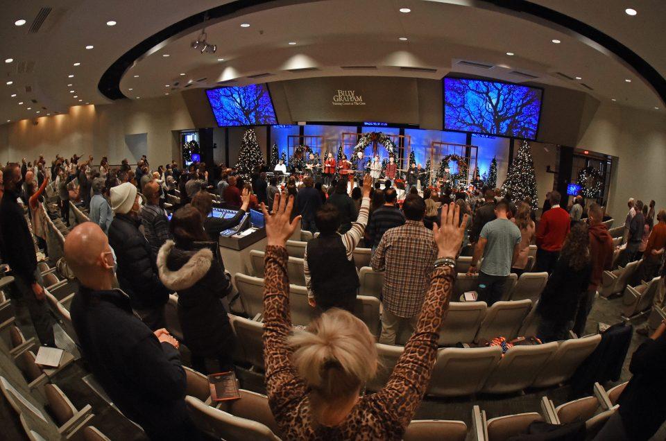 Wideshot of people worshiping at the Military Chaplain Retreat