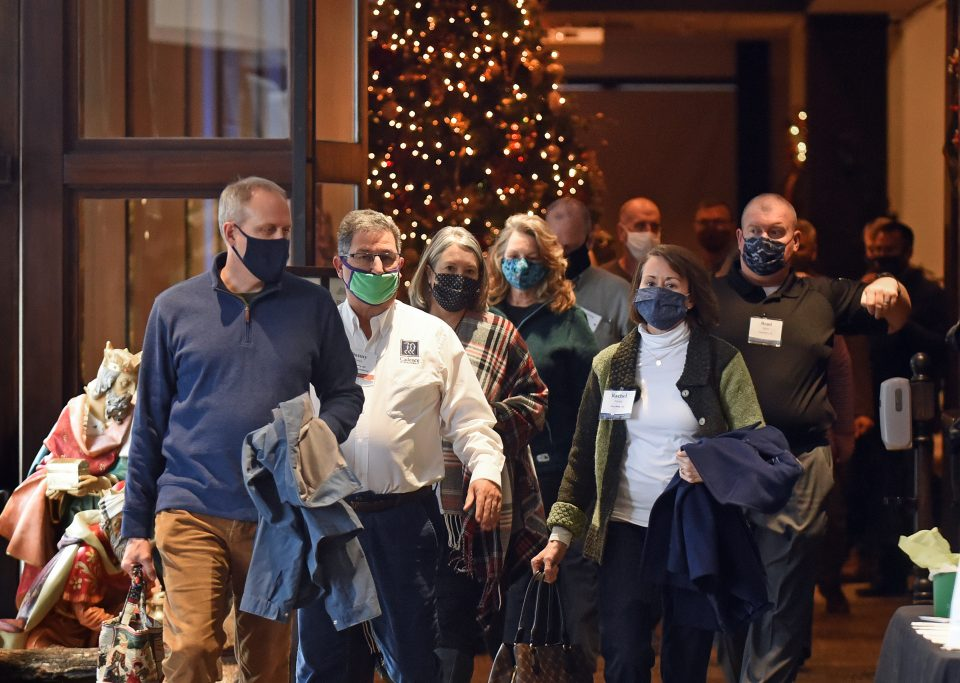 People walking inside with masks on