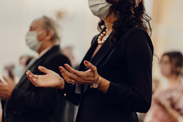 Woman worshipping at church