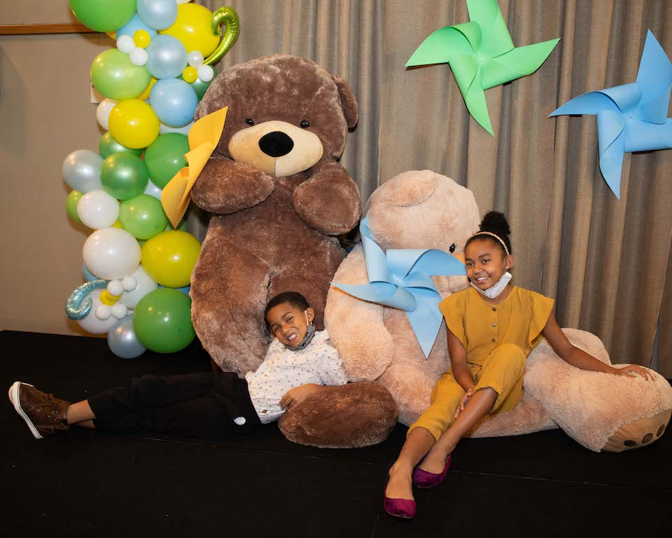 kids with giant teddy bears