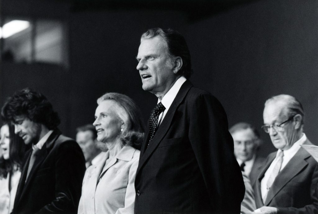 Billy Graham singing alongside Ruth Graham