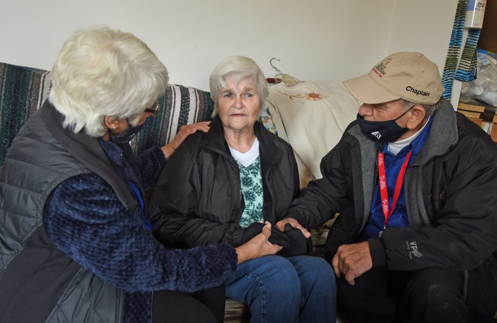 chaplains with an elderly woman