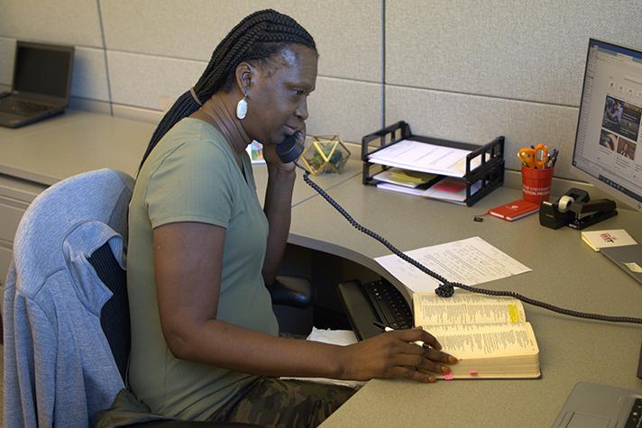 Prayer line representative listening on phone