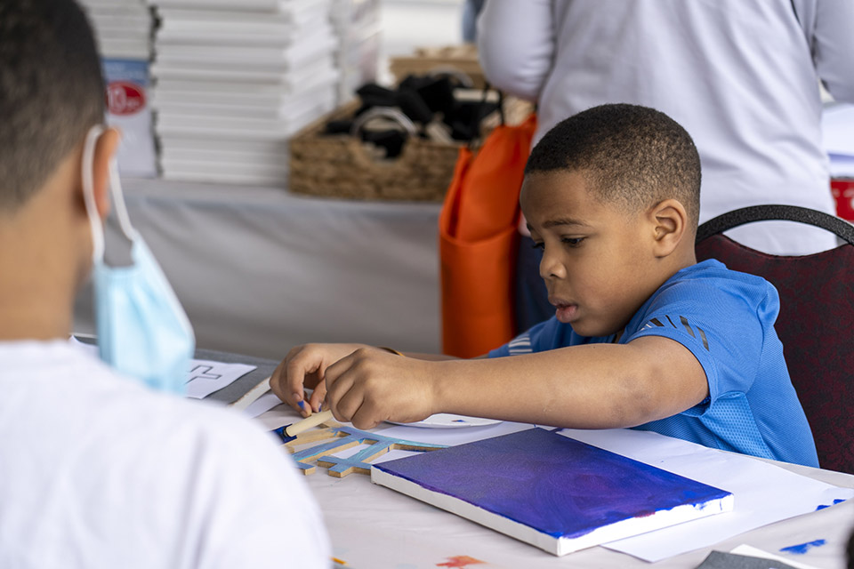 Boy making a piece of art on canvas