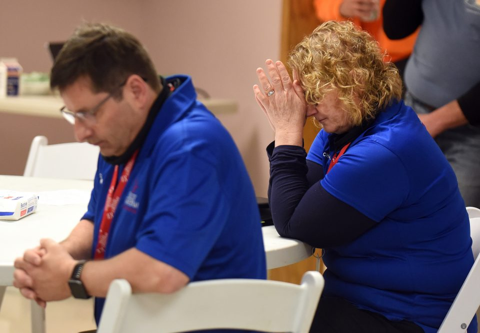 Two chaplains praying together