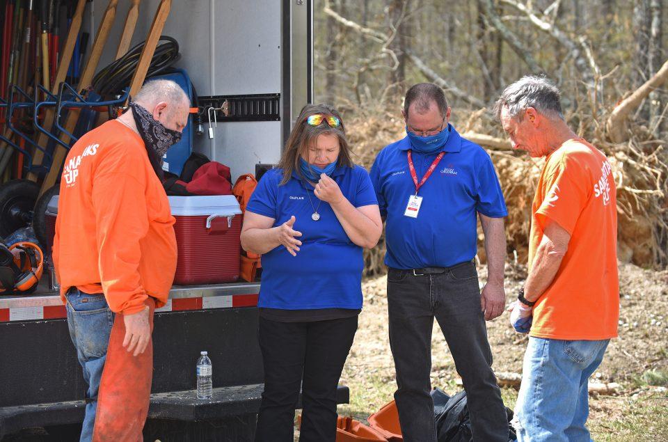 Chaplains and Samaritan's Purse volunteers pray at work site