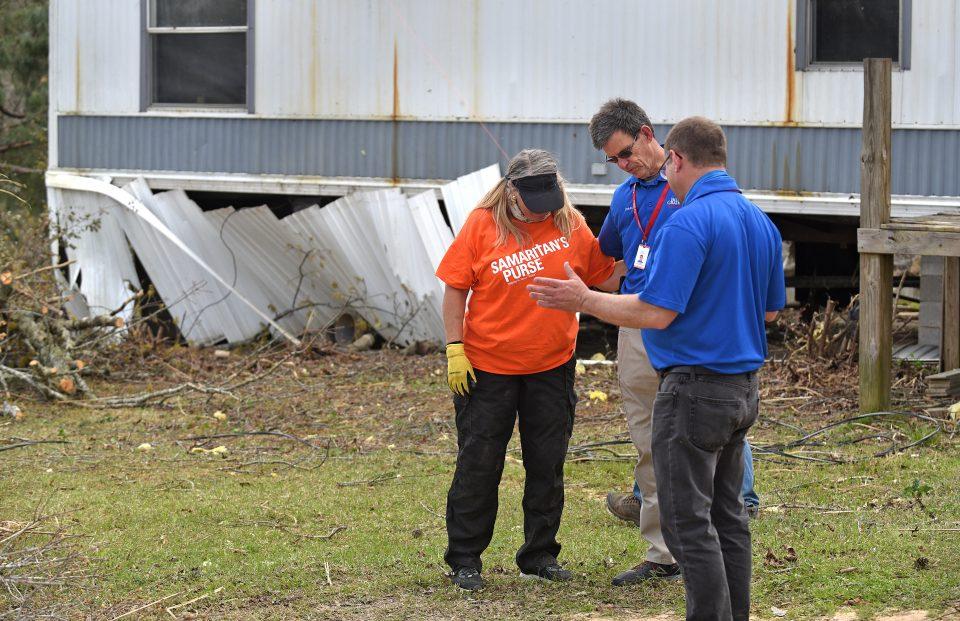Chaplains pray with Samaritan's Purse volunteer
