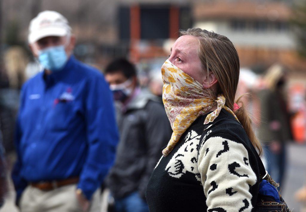 Woman cries at memorial
