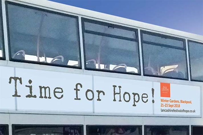 """Ad on side of bus that reads """"Time for hope!"""""""