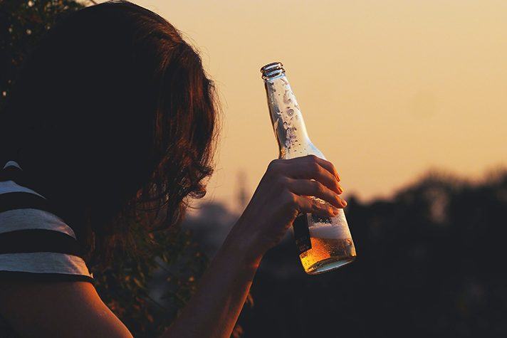 woman with bottle of alcohol