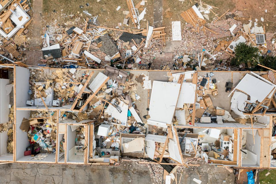 A drone view of destroyed homes after a tornado