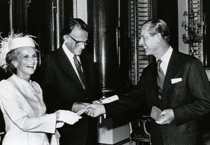 Prince Philip smiling with Ruth and Billy Graham
