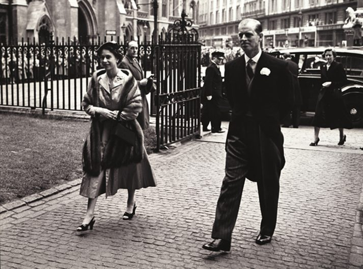 Queen Elizabeth II walking with Prince Philip