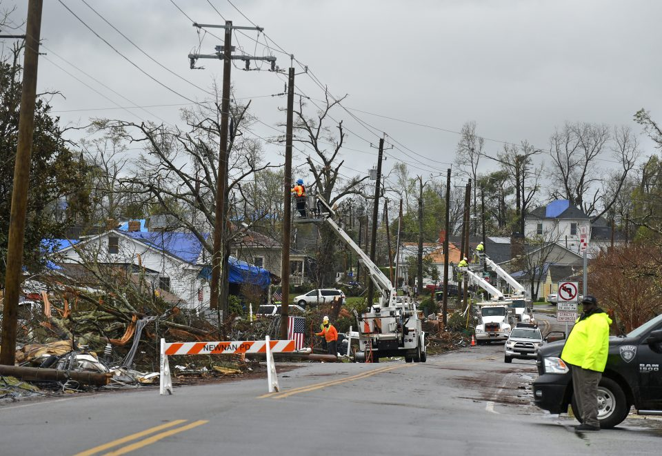 Power line crews busy at work