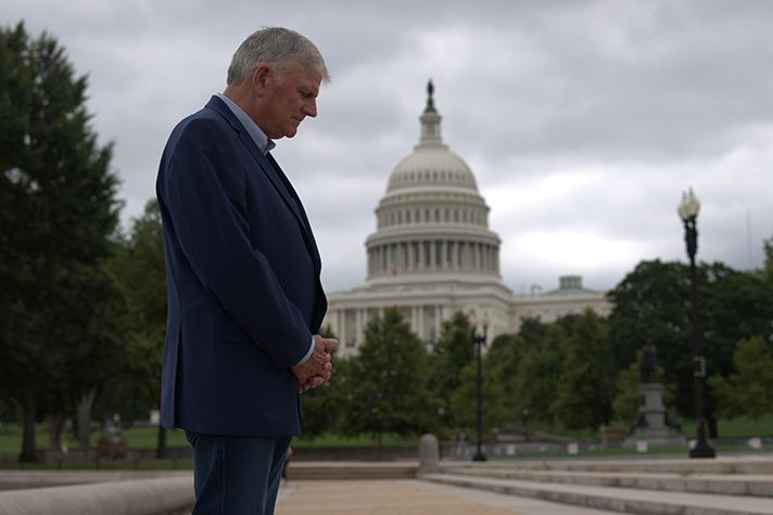 Franklin Graham prays in front of U.S. Capitol