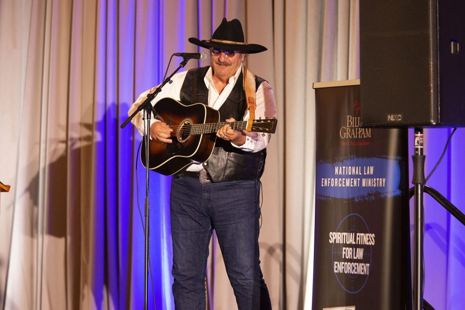 Dennis Agajanian playing guitar