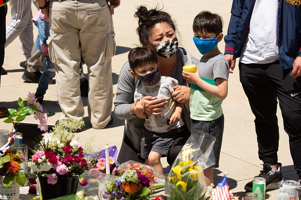 mother with young boys at memorial site